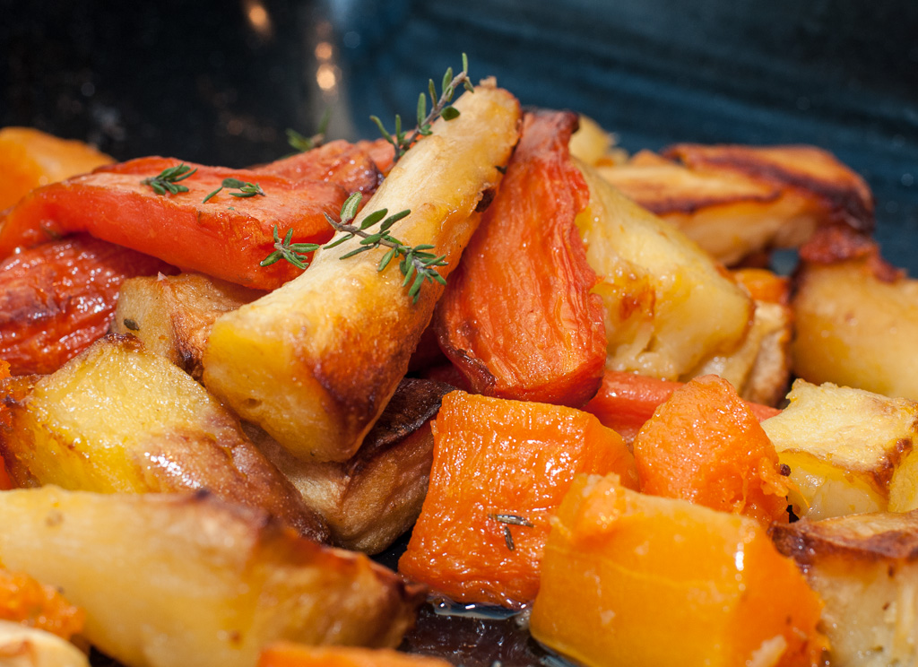 burnished chicken thighs with roasted sweet potatoes parsnips carrots ...