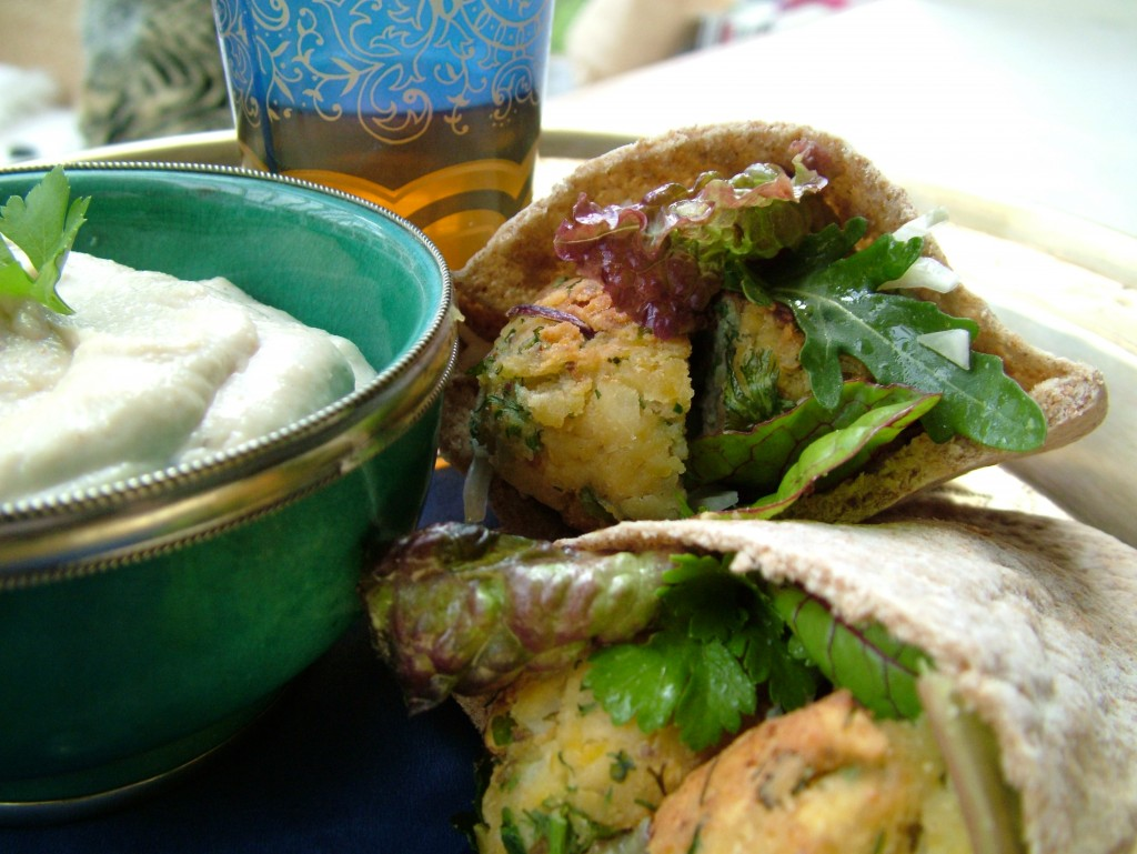 Moroccan style falafel in pitta bread with a tahini and yogurt dip